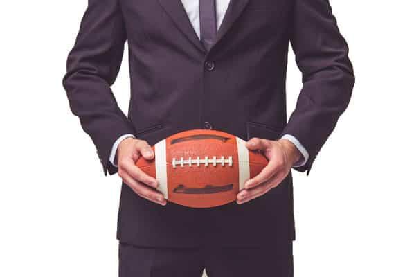 businessman holding football