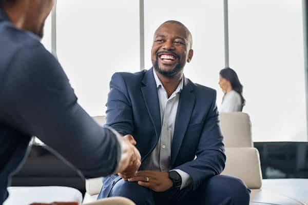 business development coaching - networking handshake
